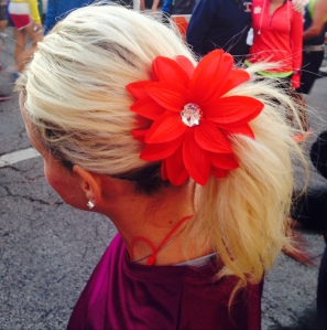 """Bloom, baby. Bloom."" With a red Fellow Flower in her hair, Tori had the strength to cross the finish line."