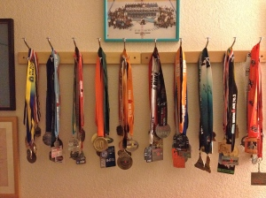 As if I need another marathon medal. OK, most of these belong to Michael K. Farrell… But still. I don't run for the hardware, I run for the love.